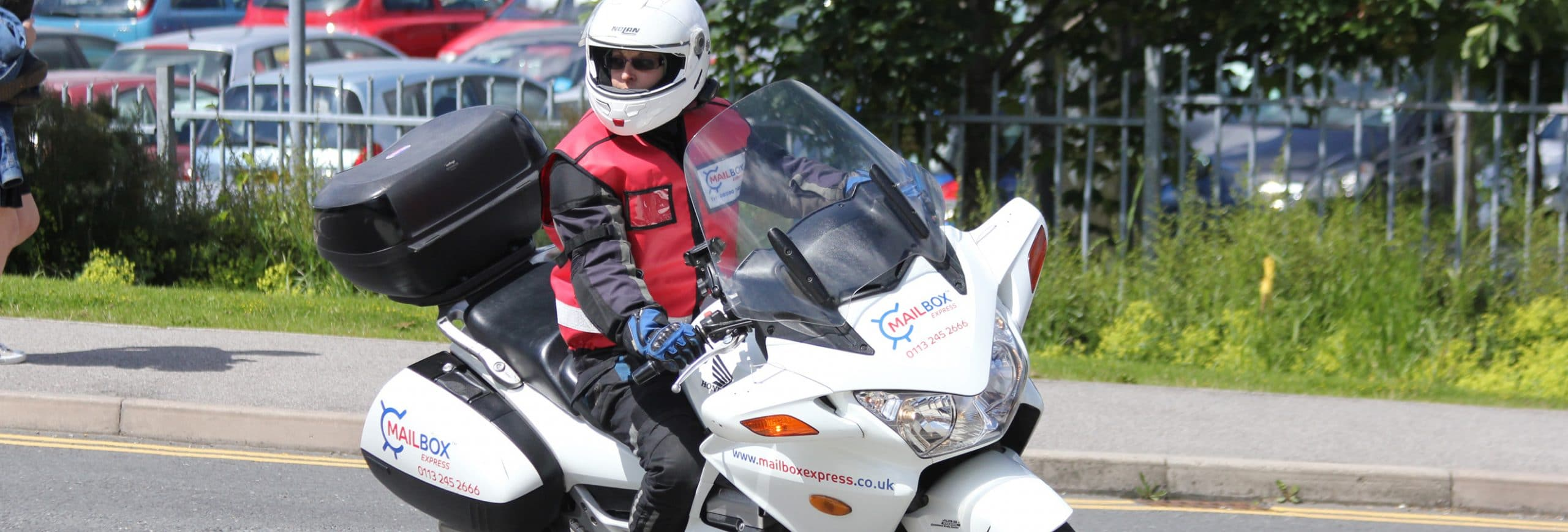 Man on motorbike branded with Mailbox Express